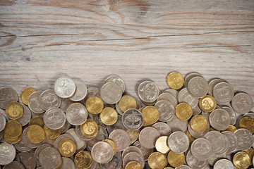 Top view coins on old wooden desk
