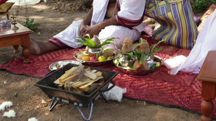 wedding accessories lay near hindu bramin on indian wedding