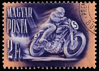 Stamp printed in Hungary shows motor racing