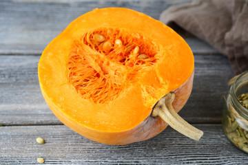 Fresh half pumpkin on the boards