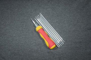 Screwdriver  of fabric background