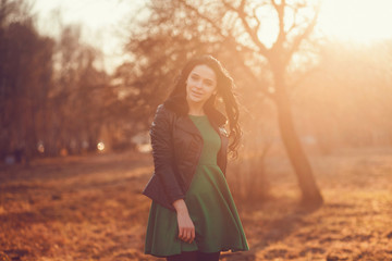 Portrait of a cute brunette in autumn park