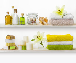 Wooden shelves with various spa accessories isolated on white