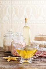 Jug of golden liquid soap on wooden table