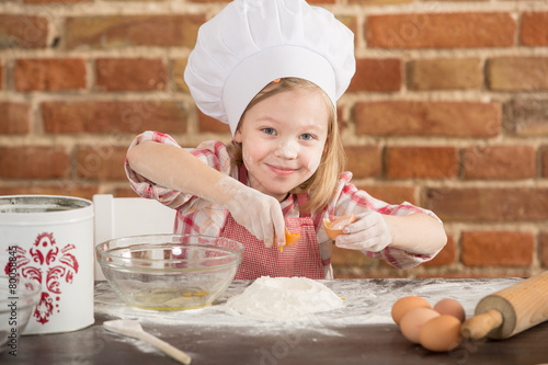 Happy little chef in the kitchen  - 80058845