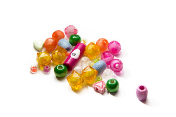a handful of beads isolated on white background