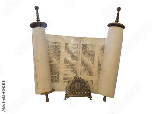 The Jewish Torah scroll and a gold menorah candle support isolat