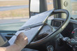 Truck driver is writing in the ocumentation. - 80063624