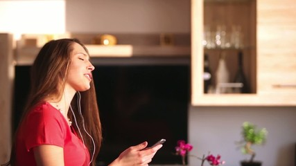 Attractive young woman listening music at home