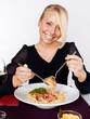 Woman eating spaghetti