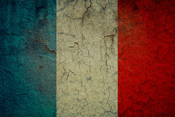 The French flag painted on grunge wall