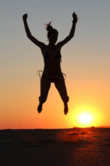 Girl silhouette jumping