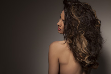 back view of beautiful brunette posing in the studio