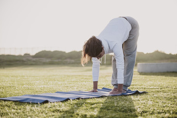 Young woman warming up for a yoga session