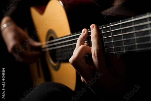 Man playing acoustic guitar - 80069296