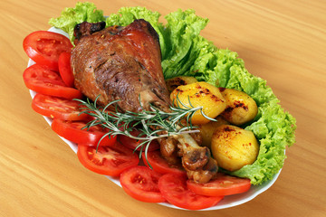 turkey drumstick with vegetables on plate