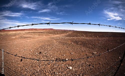 Leinwandbild Motiv Barbed Wire in the Desert