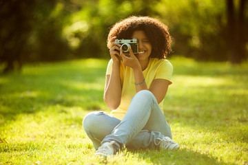 Young woman enjoying summer and photographing