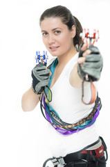 Woman equipped with climbing gear
