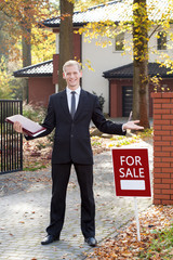 Happy estate agent during his work