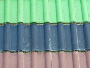 Old green, blue, brown roof tiles background
