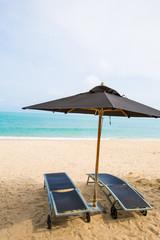 Beach chairs with umbrella at beach