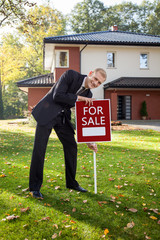 Estate agent trying to sell house