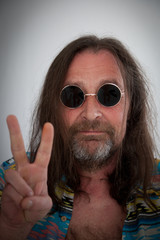 male hippie  making a peace sign with his fingers