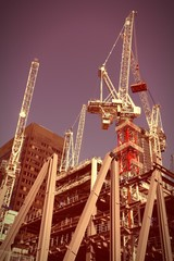 Urban development - London construction. Cross processed tone.