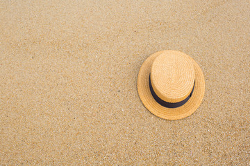 straw hat on the shore of a beach