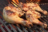 Marinated Chicken Legs Fried On The Hot Flaming BBQ Grill