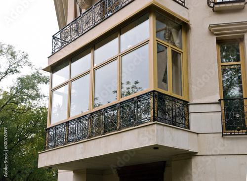 New fiberglass balcony glazing in city house