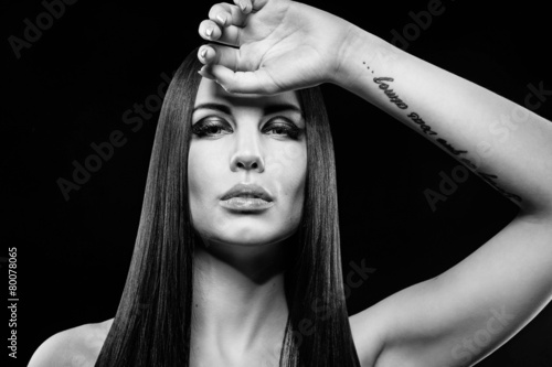 Beautiful portrait of Brunette woman with long hair and make-up © flywish