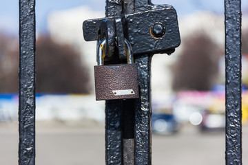 The lock on the fence