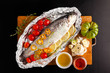 raw fish with vegetables on wooden board