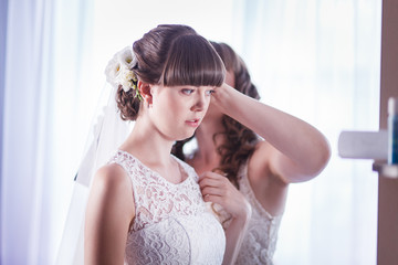bride adjusts the veil