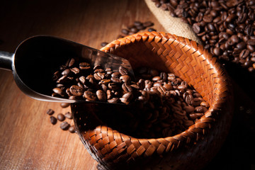 roasted coffee beans in a bamboo basket