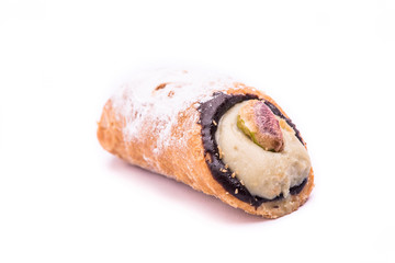 """cannolo"" italian sicilian pastry with pistachio isolated on whi"
