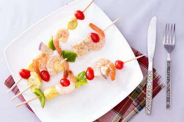 Gourmet Shrimp Skewers or Kebabs on White Plate