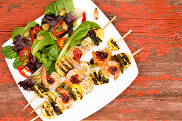 Shrimp Skewers on Plate with Veggies and Spices