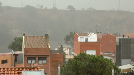 Heavy Rain Over Residential Buildings