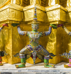 Green demon guardian supporting Wat Arun Temple, Thailand