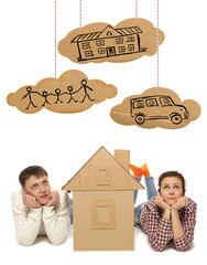 Couple with house of cardboard