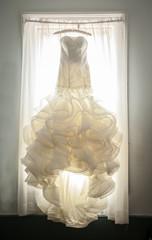 extravagant wedding dress in window
