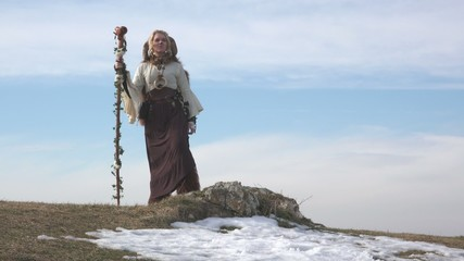 Female Druid standing on mountain