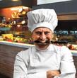 cuoco aggressivo in cucina