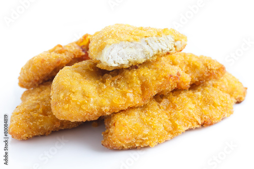 Golden fried chicken strips on white. - 80084819