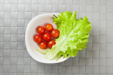 fresh vegetables on plate, grey place mat background