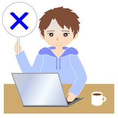 自宅でパソコンをする男性