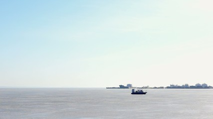 Hovercraft on icy lake coming to pier